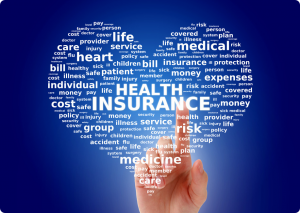 health insurance words in a heart shape with an index finger pointing upward